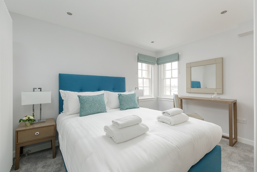 Modern bright bedroom at Royal Mile Residence Apartments - Citybase Apartments