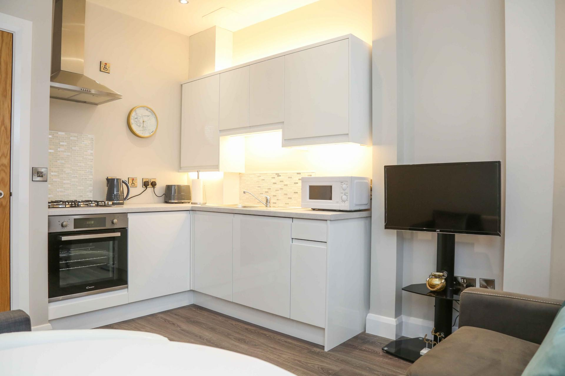 White kitchen at Eglantine Apartments - Citybase Apartments
