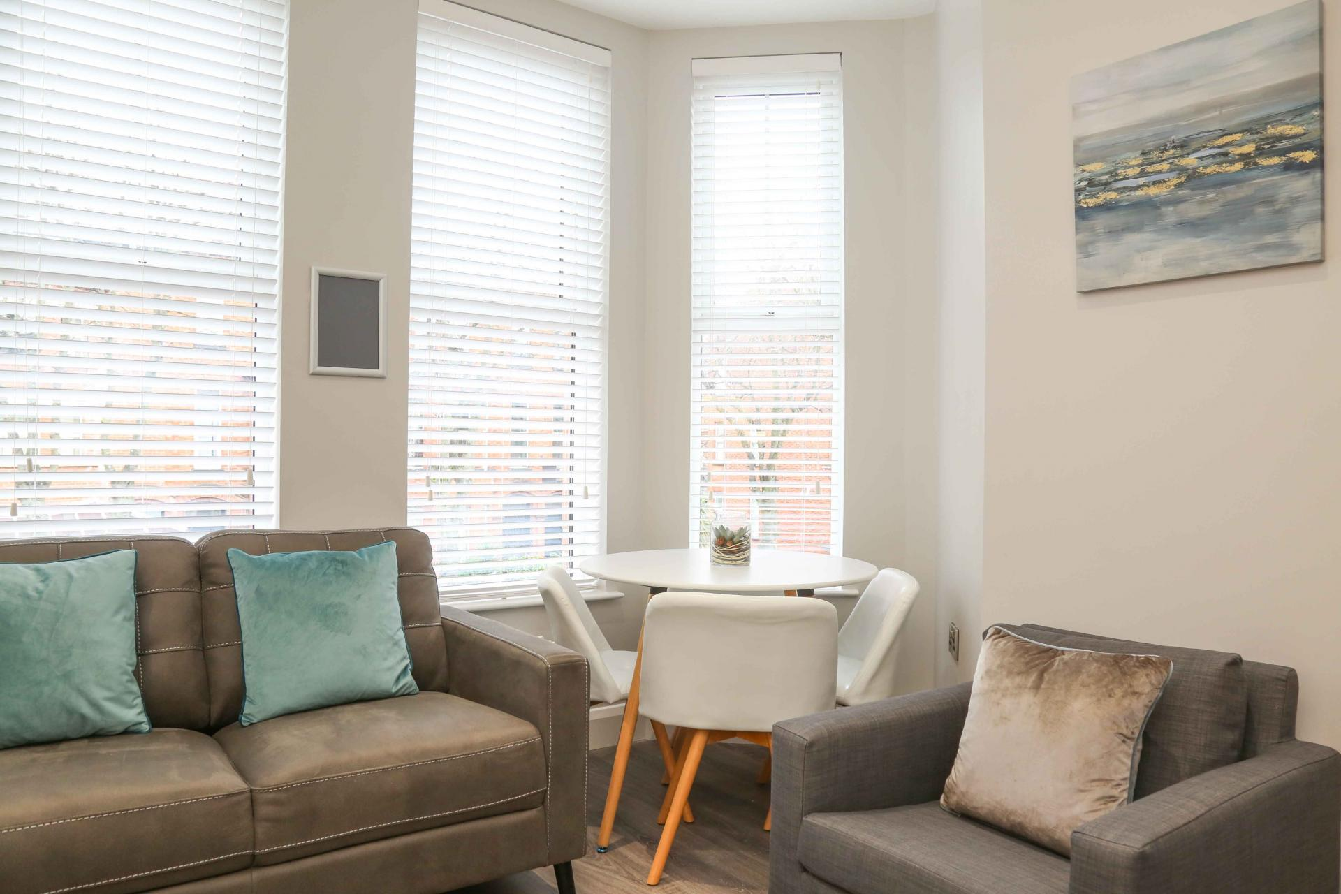 Bright living room at Eglantine Apartments - Citybase Apartments