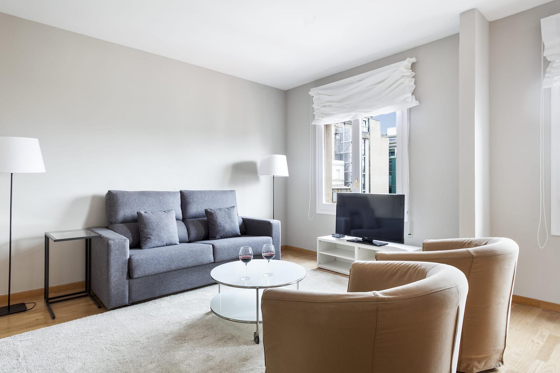 Sofa at Sunny Serviced Apartments, Eixample, Barcelona - Citybase Apartments