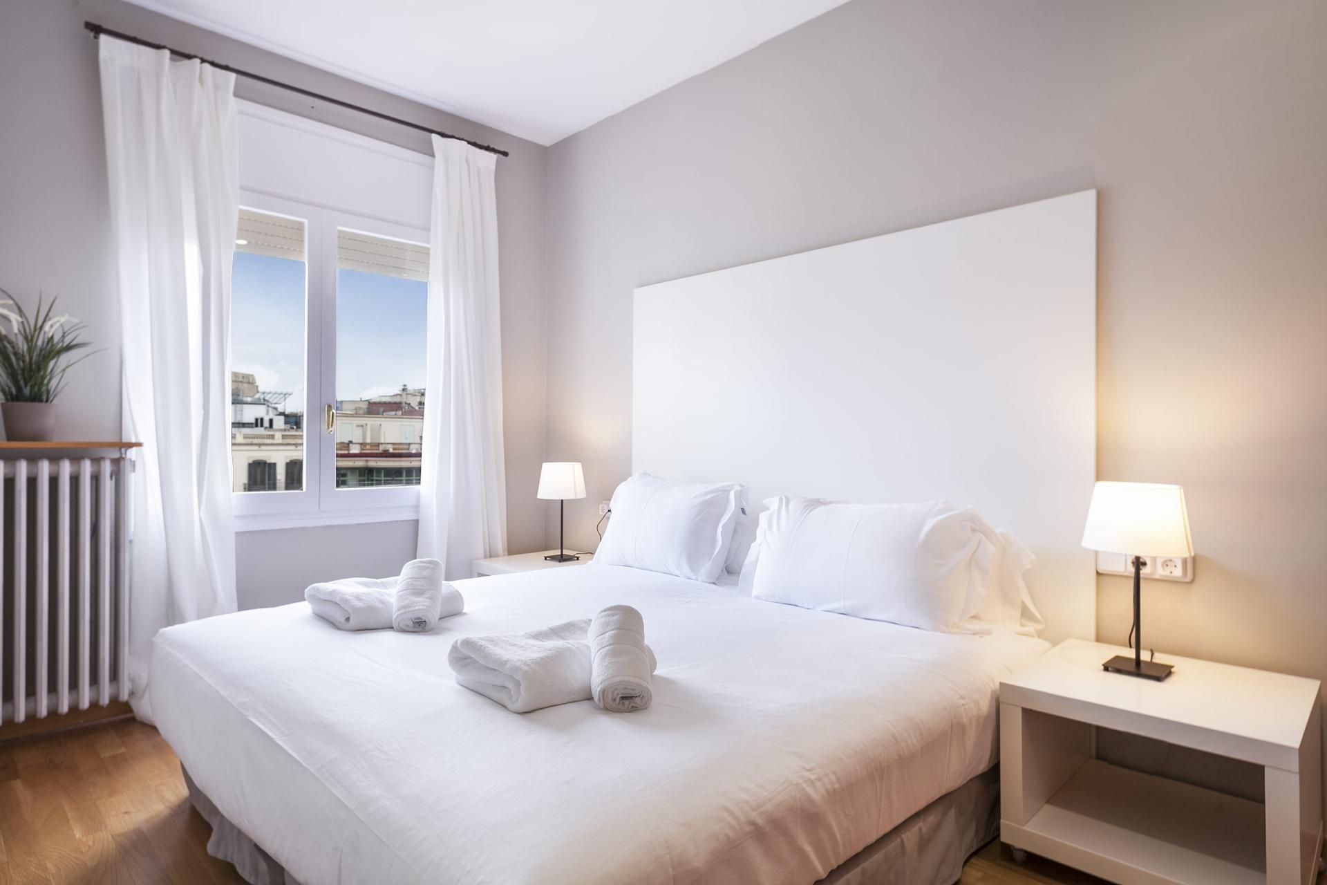 Bright bedroom at Sunny Serviced Apartments, Eixample, Barcelona - Citybase Apartments