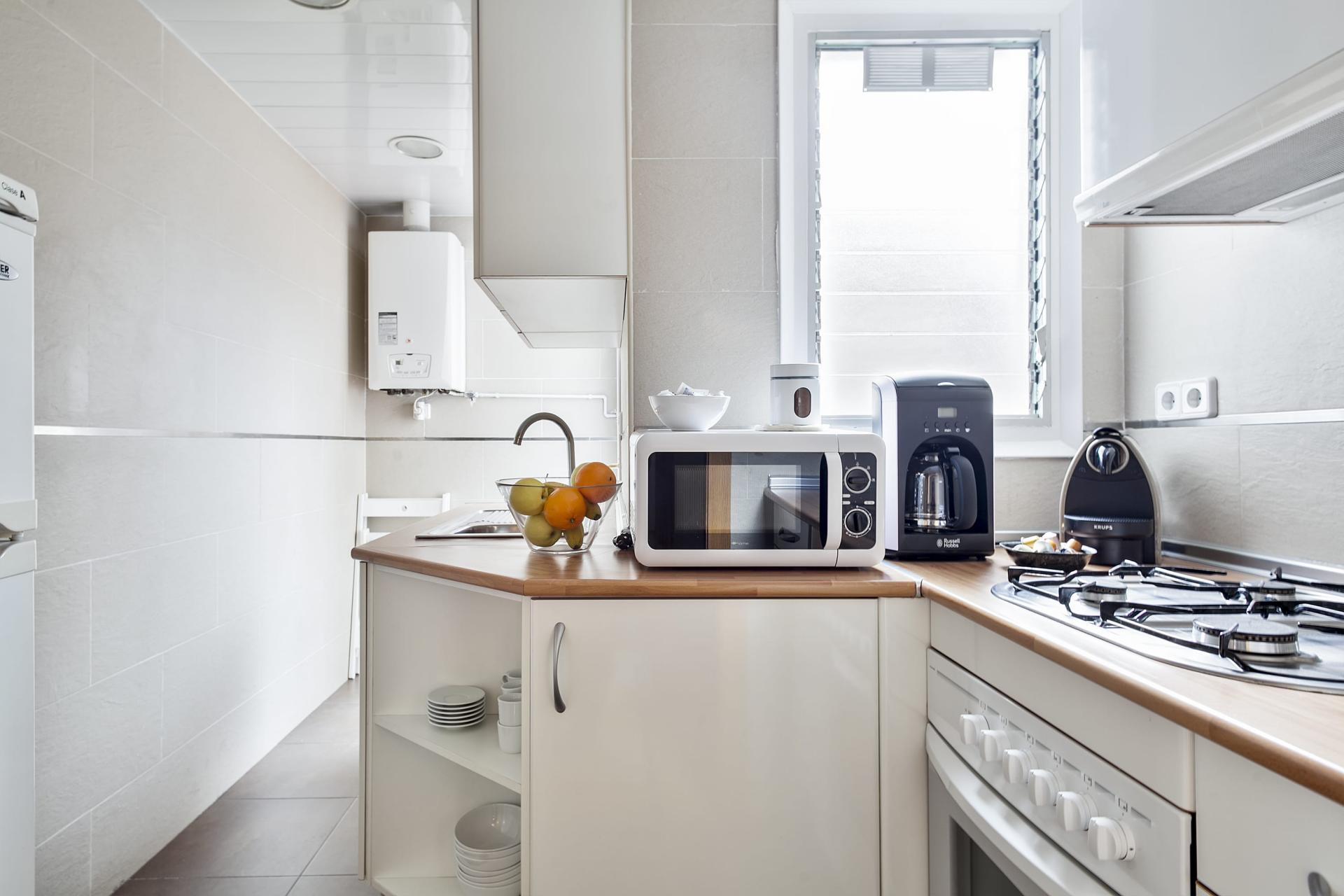 Microwave at Sunny Serviced Apartments, Eixample, Barcelona - Citybase Apartments