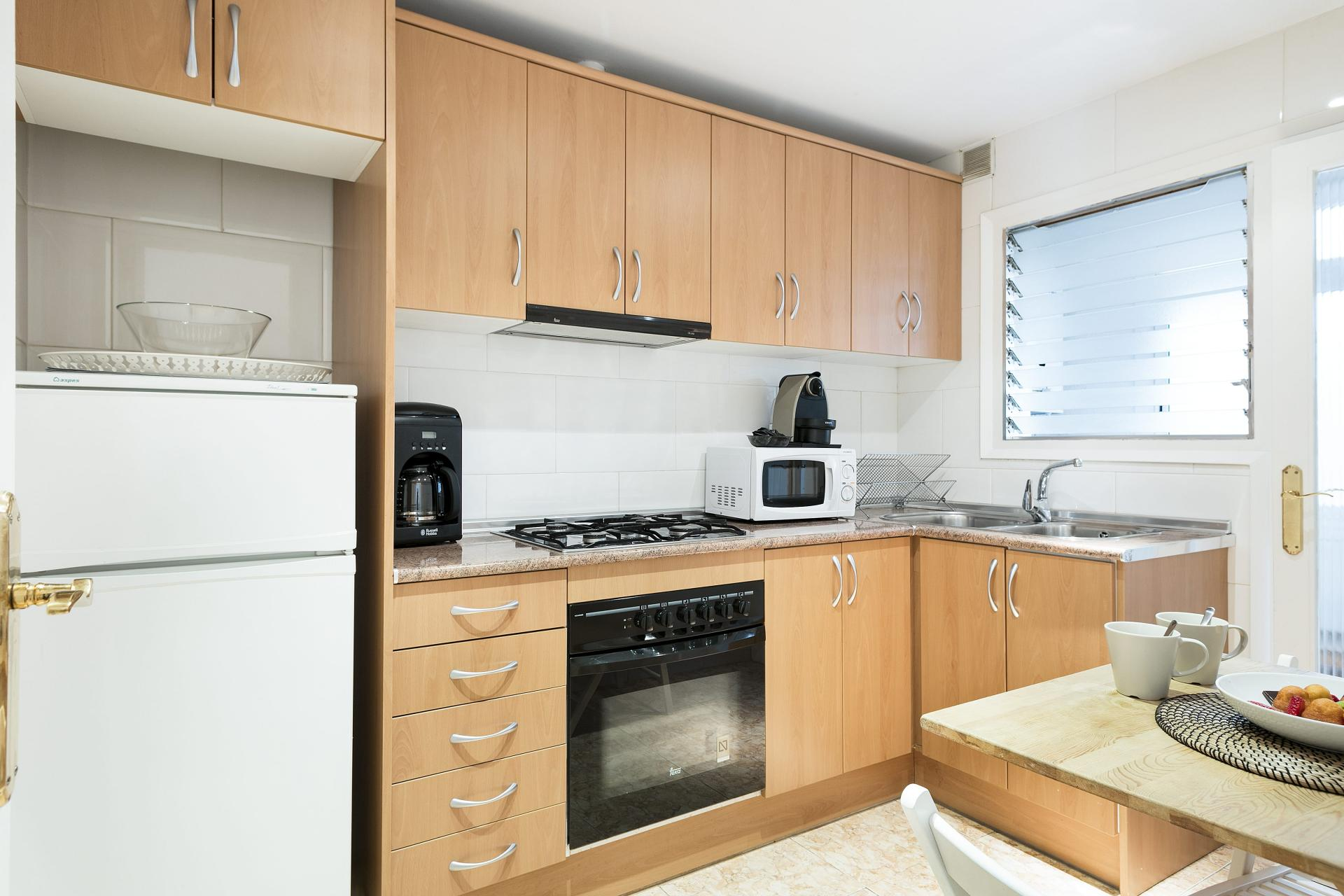 Modern kitchen at Sunny Serviced Apartments, Eixample, Barcelona - Citybase Apartments