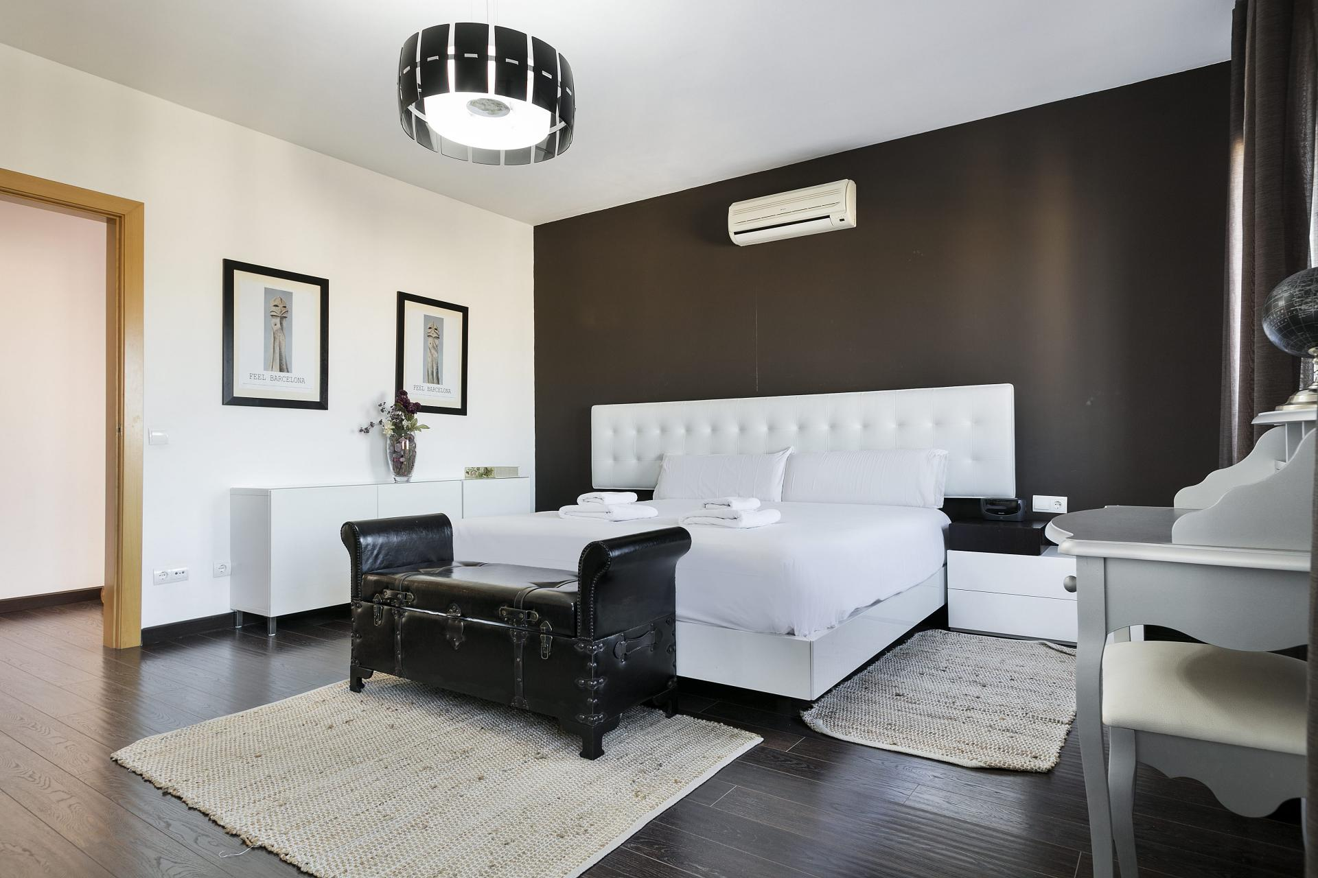 Spacious bedroom at Sunny Serviced Apartments, Eixample, Barcelona - Citybase Apartments
