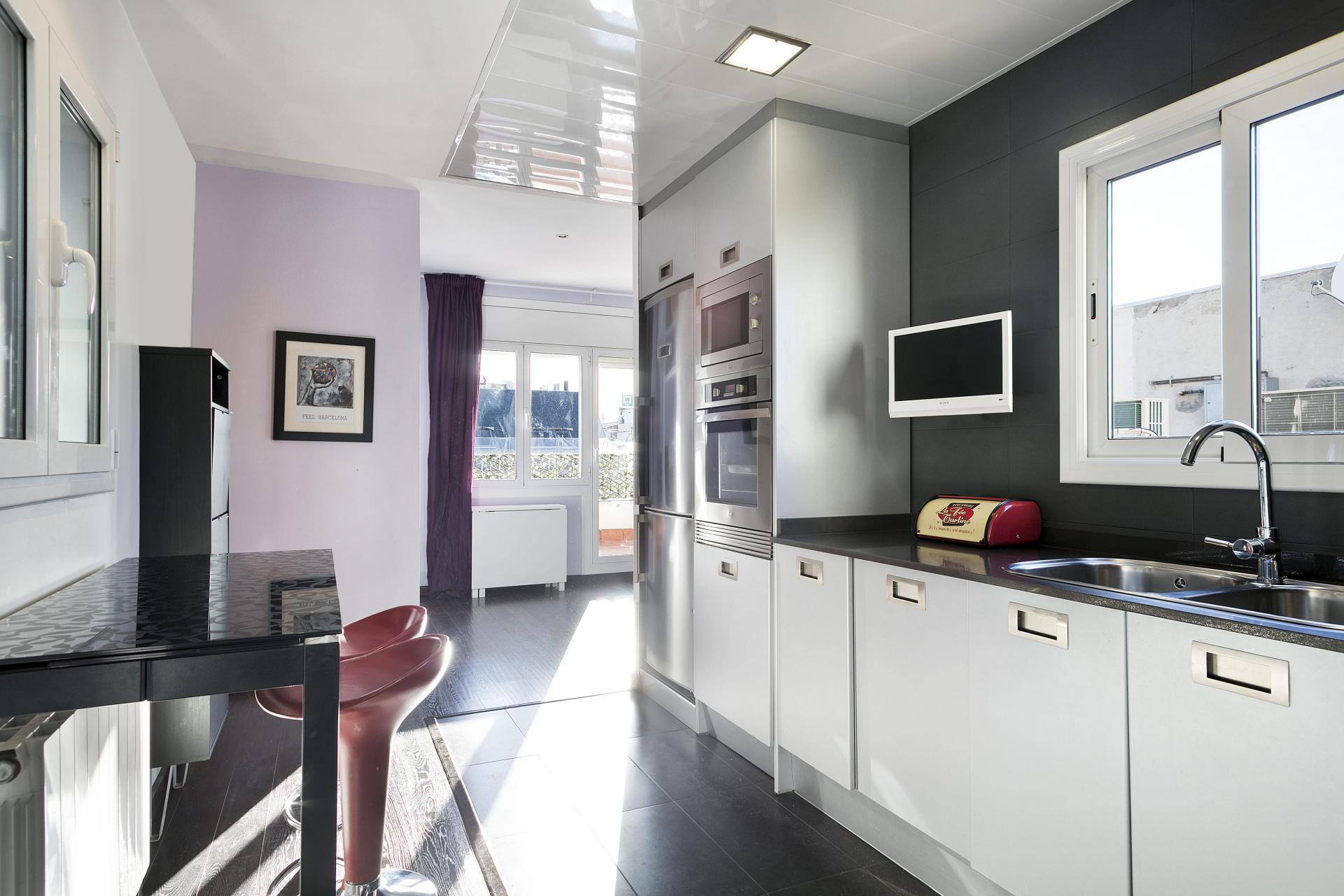 Large kitchen at Sunny Serviced Apartments, Eixample, Barcelona - Citybase Apartments