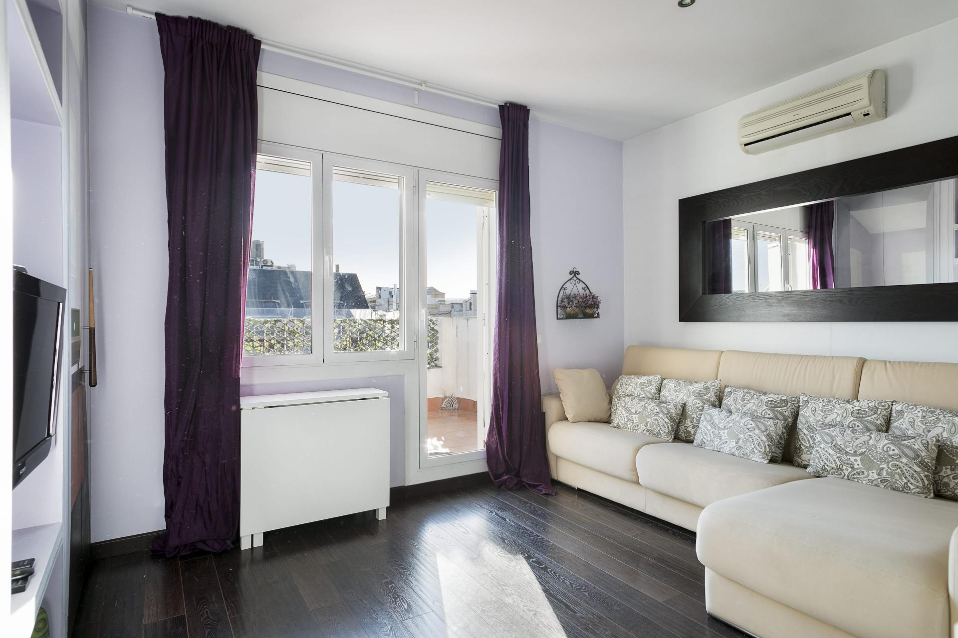 Large windows at Sunny Serviced Apartments, Eixample, Barcelona - Citybase Apartments