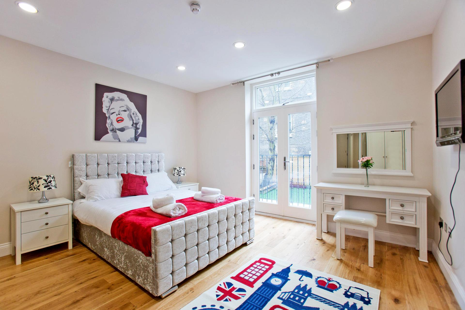 Stylish bedroom at Cromwell Road Serviced Apartments - Citybase Apartments