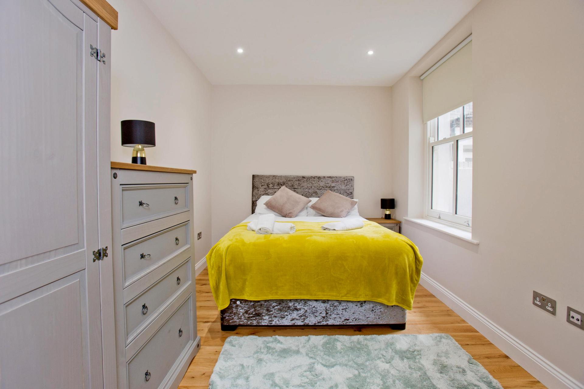 Cosy bedroom at Cromwell Road Serviced Apartments - Citybase Apartments