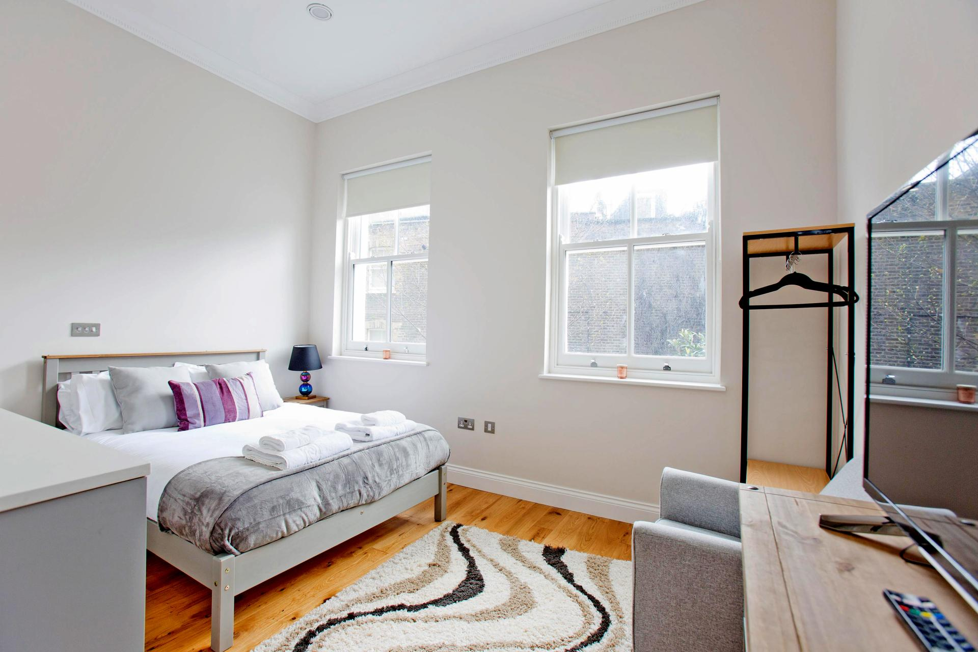 Bright bedroom at Cromwell Road Serviced Apartments - Citybase Apartments
