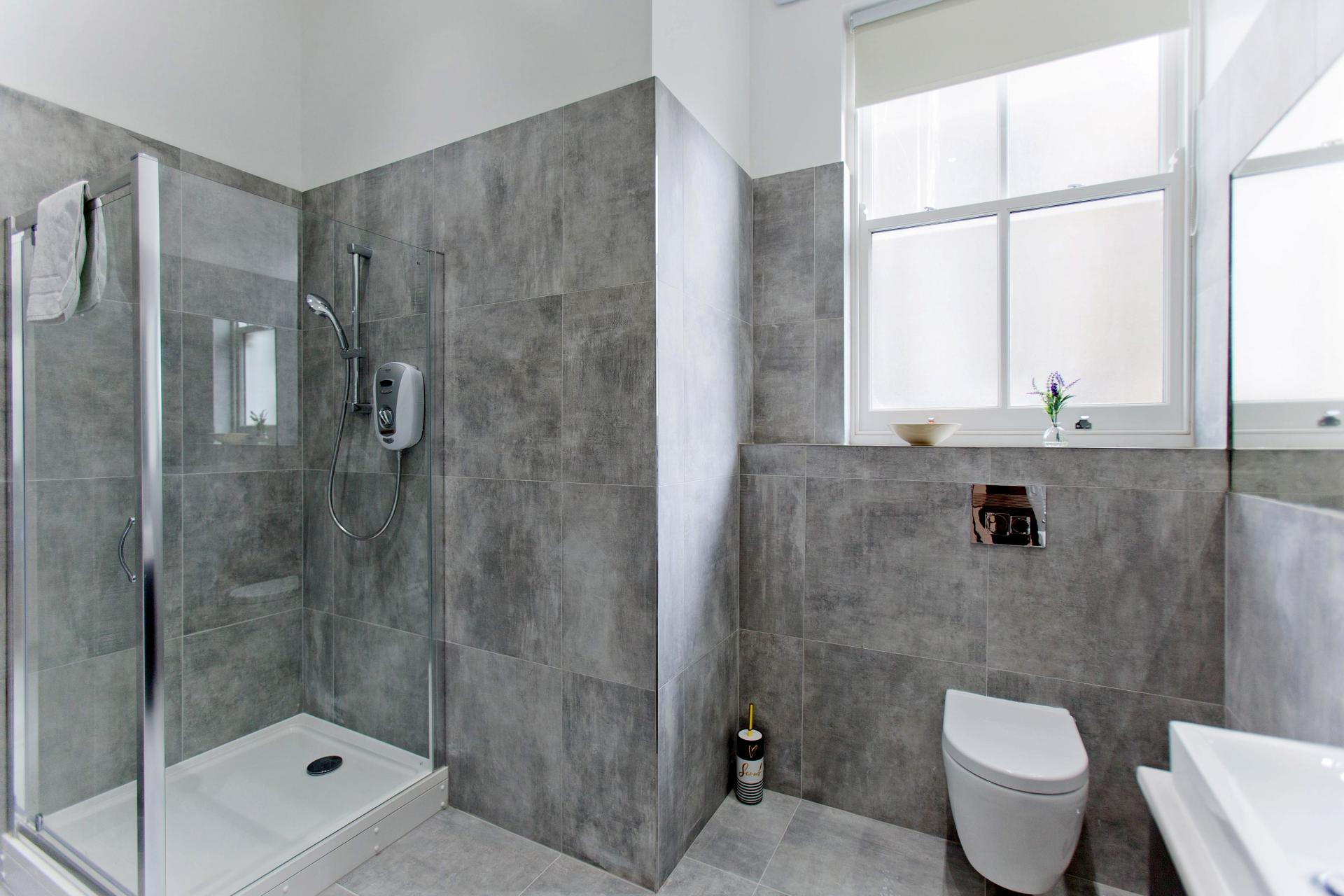 Shower at Cromwell Road Serviced Apartments - Citybase Apartments