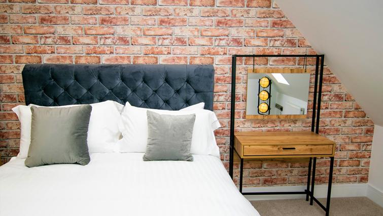 Comfortable bed at Rowan Tree Apartments - Citybase Apartments