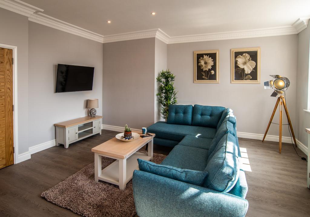 Living room at Juniper Court Apartments - Citybase Apartments