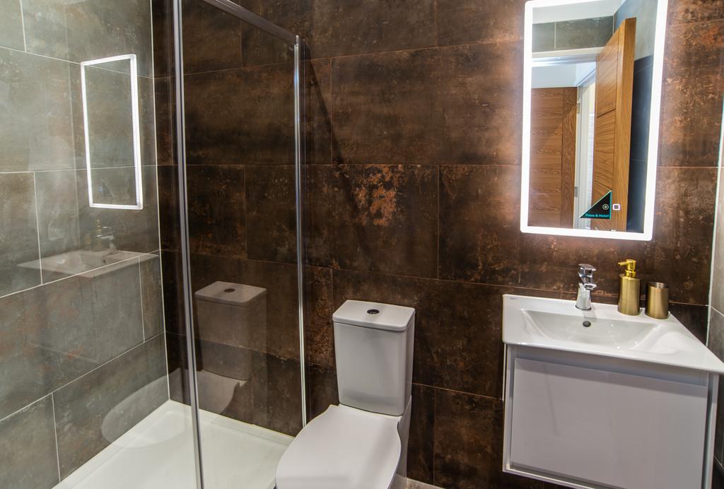 Bathroom at Juniper Court Apartments - Citybase Apartments