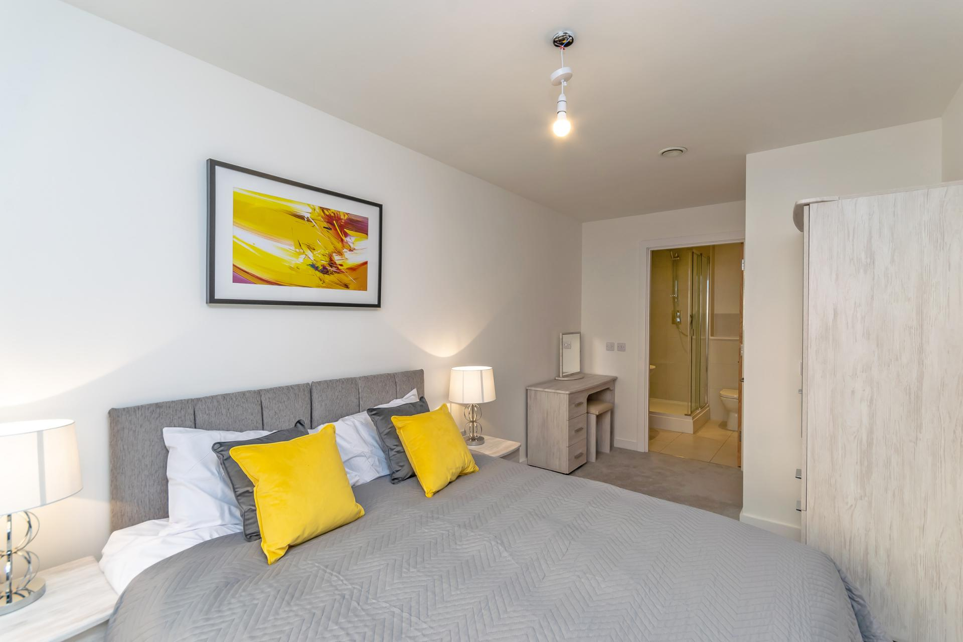 Yellow bed at Halo House Serviced Apartments, Green Quarter, Manchester - Citybase Apartments