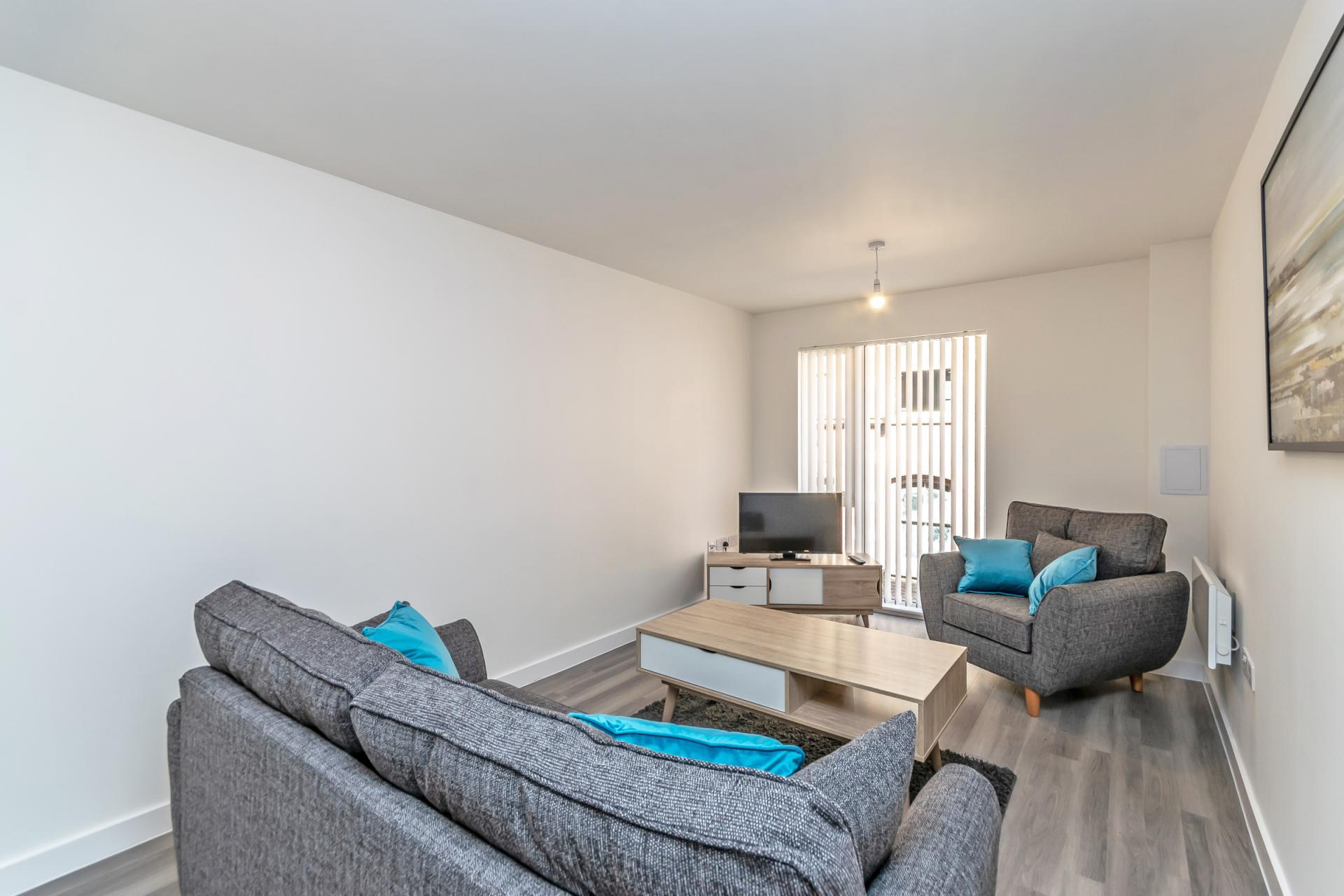 Blue cushions at Halo House Serviced Apartments, Green Quarter, Manchester - Citybase Apartments