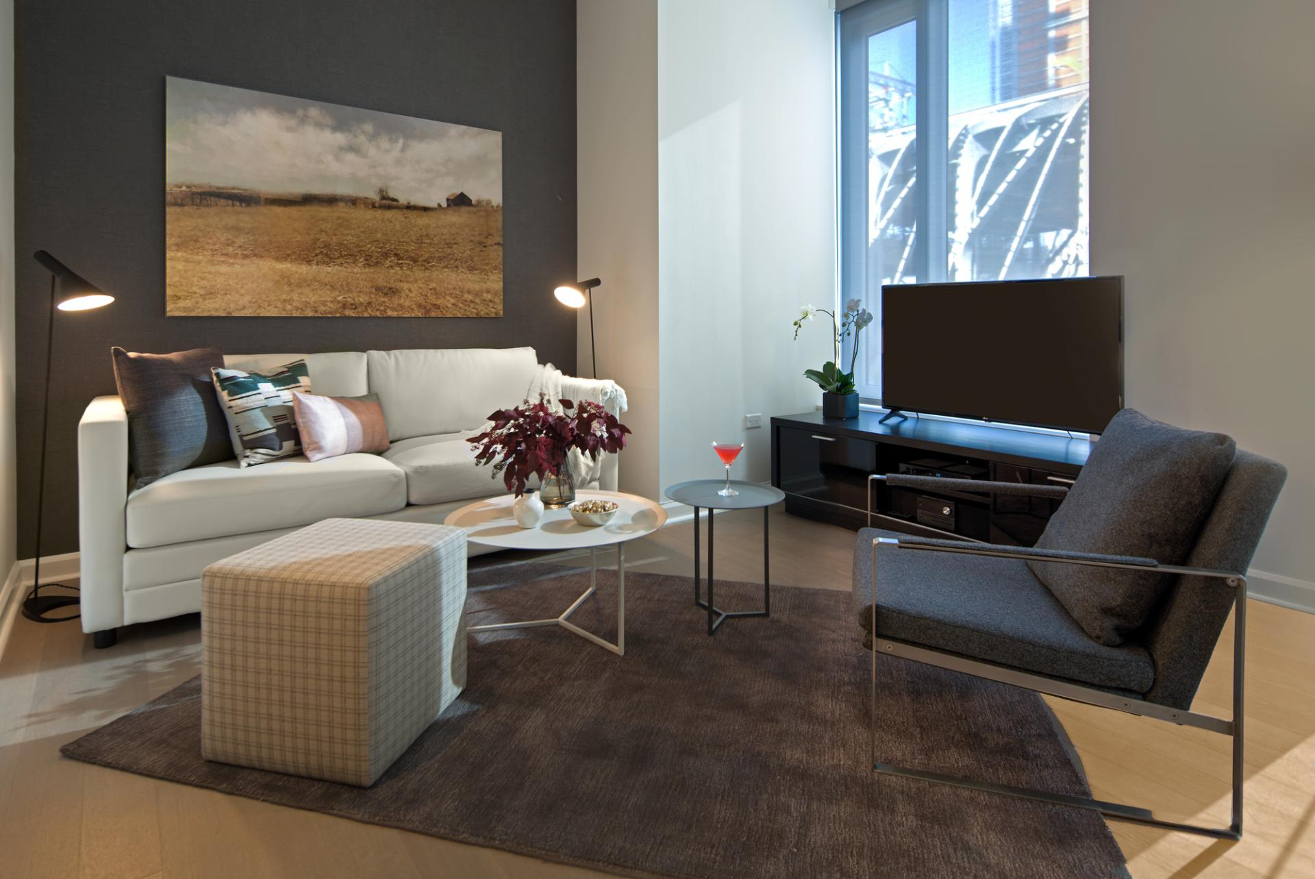 Living area at One Hudson Yards Apartments - Citybase Apartments
