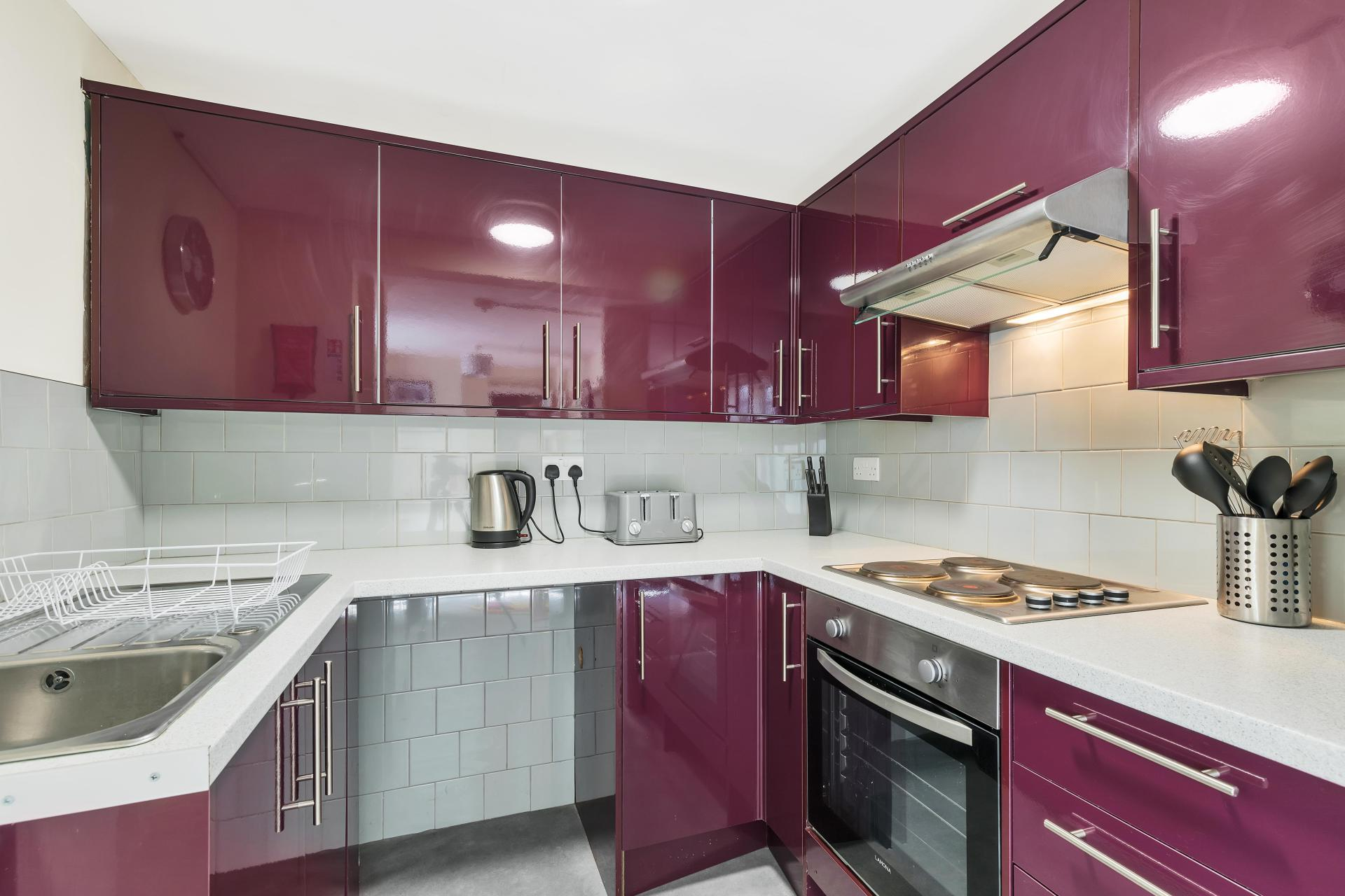 Kitchen at Beach Patio Apartment - Citybase Apartments