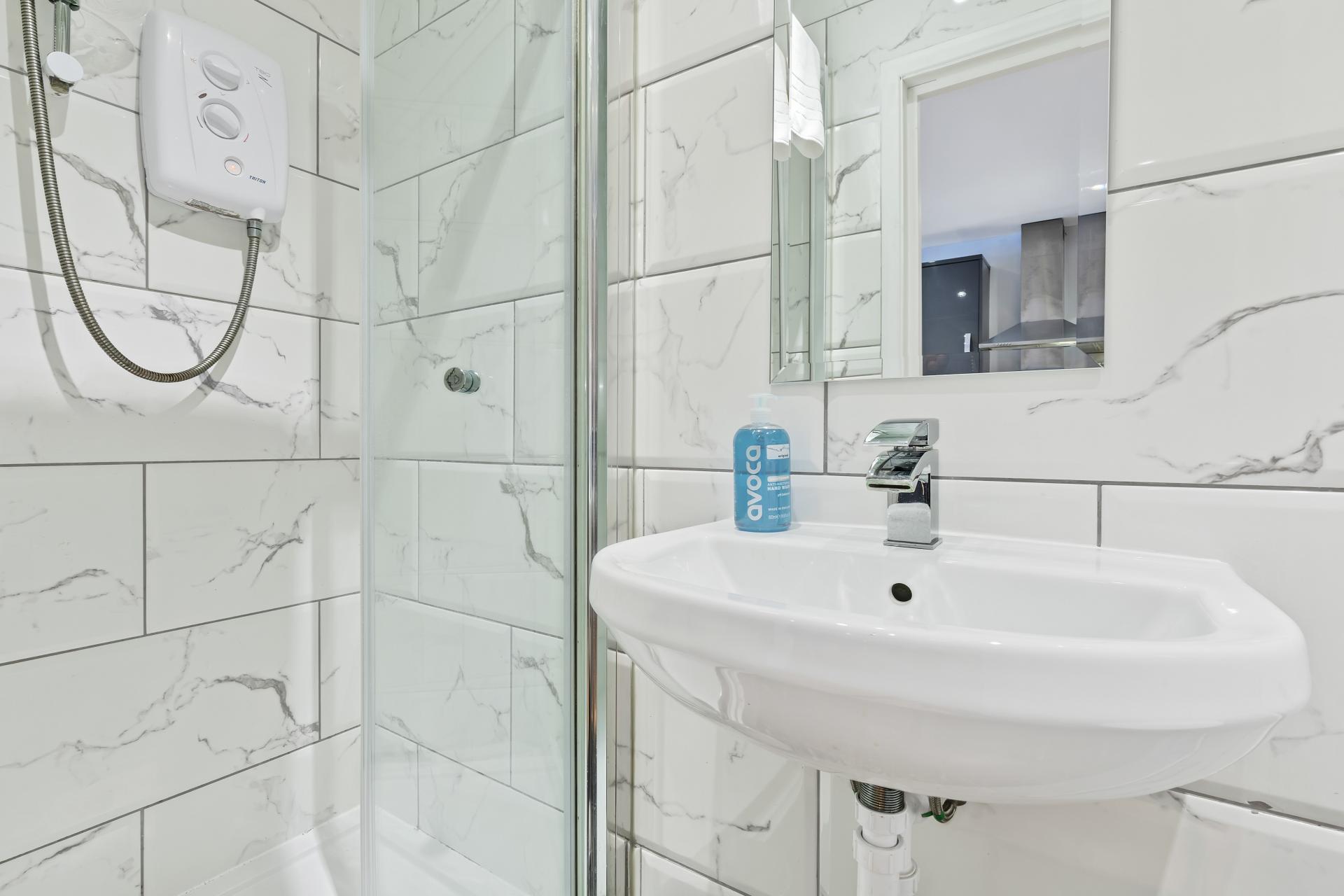 Bathroom at Rainbow Studio Apartment - Citybase Apartments