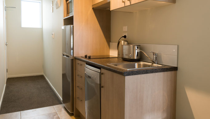 Kitchen facilities at Ramada Suites by Wyndham Christchurch City - Citybase Apartments