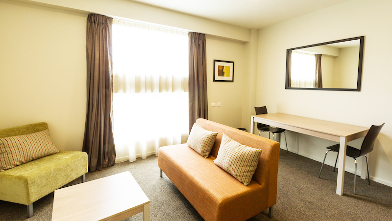 Living room at Ramada Suites by Wyndham Christchurch City - Citybase Apartments
