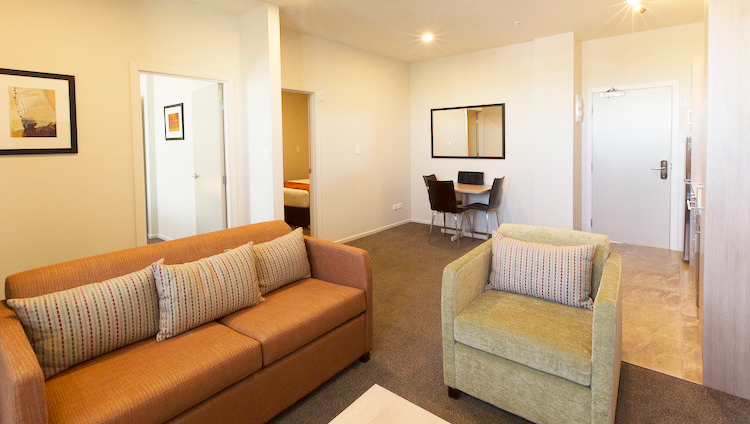 Sofa at Ramada Suites by Wyndham Christchurch City - Citybase Apartments