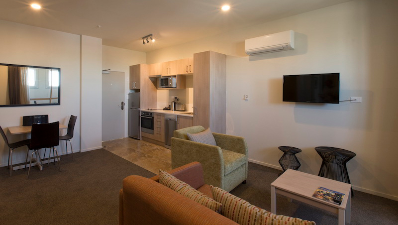 Open-plan living area at Ramada Suites by Wyndham Christchurch City - Citybase Apartments