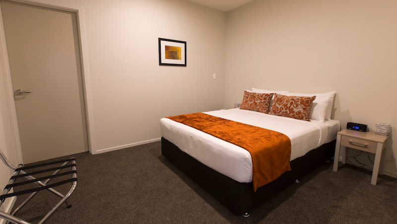 Cosy bedroom at Ramada Suites by Wyndham Christchurch City - Citybase Apartments
