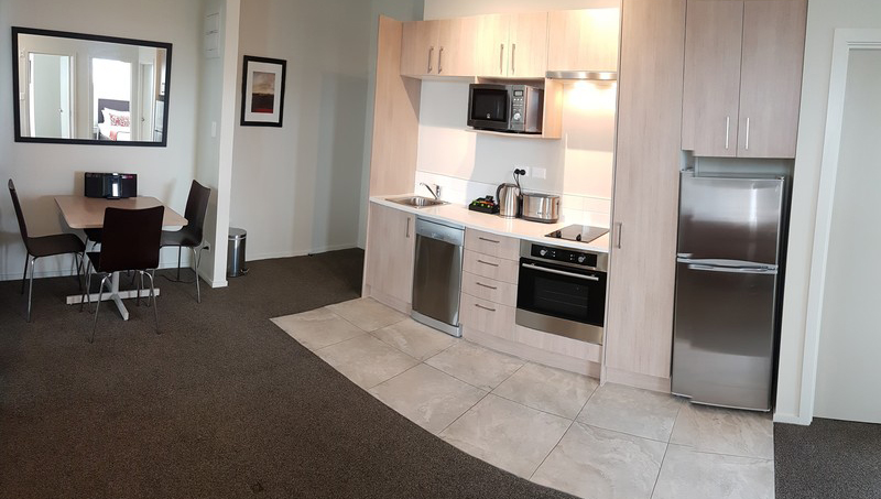 Kitchen at Ramada Suites by Wyndham Christchurch City - Citybase Apartments