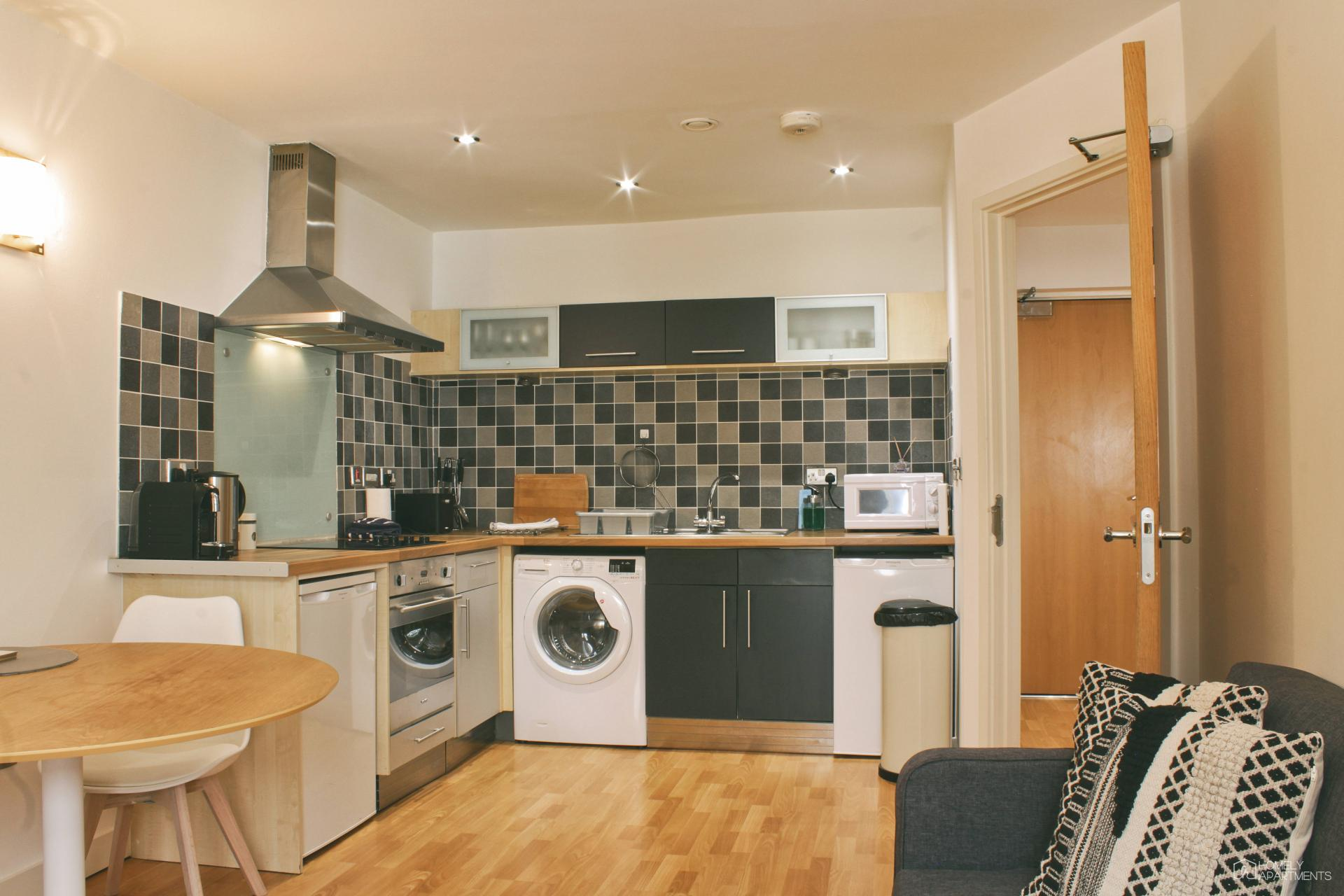 Washing machine at West One Serviced Apartments - Citybase Apartments