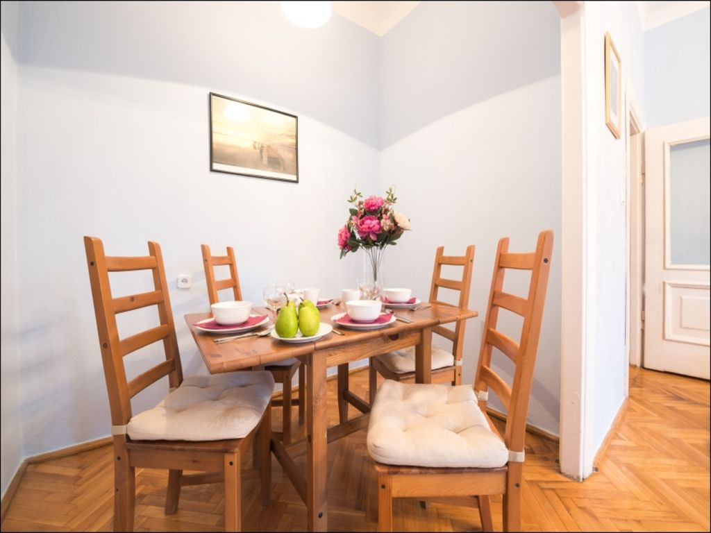 Dining table at Old Town Square Apartments - Citybase Apartments