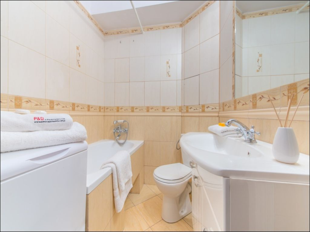 Bright bathroom at Old Town Square Apartments - Citybase Apartments
