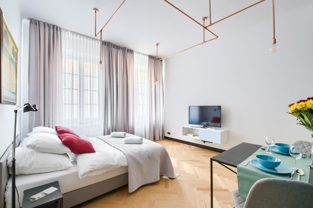 Sleek bedroom at Old Town Square Apartments - Citybase Apartments