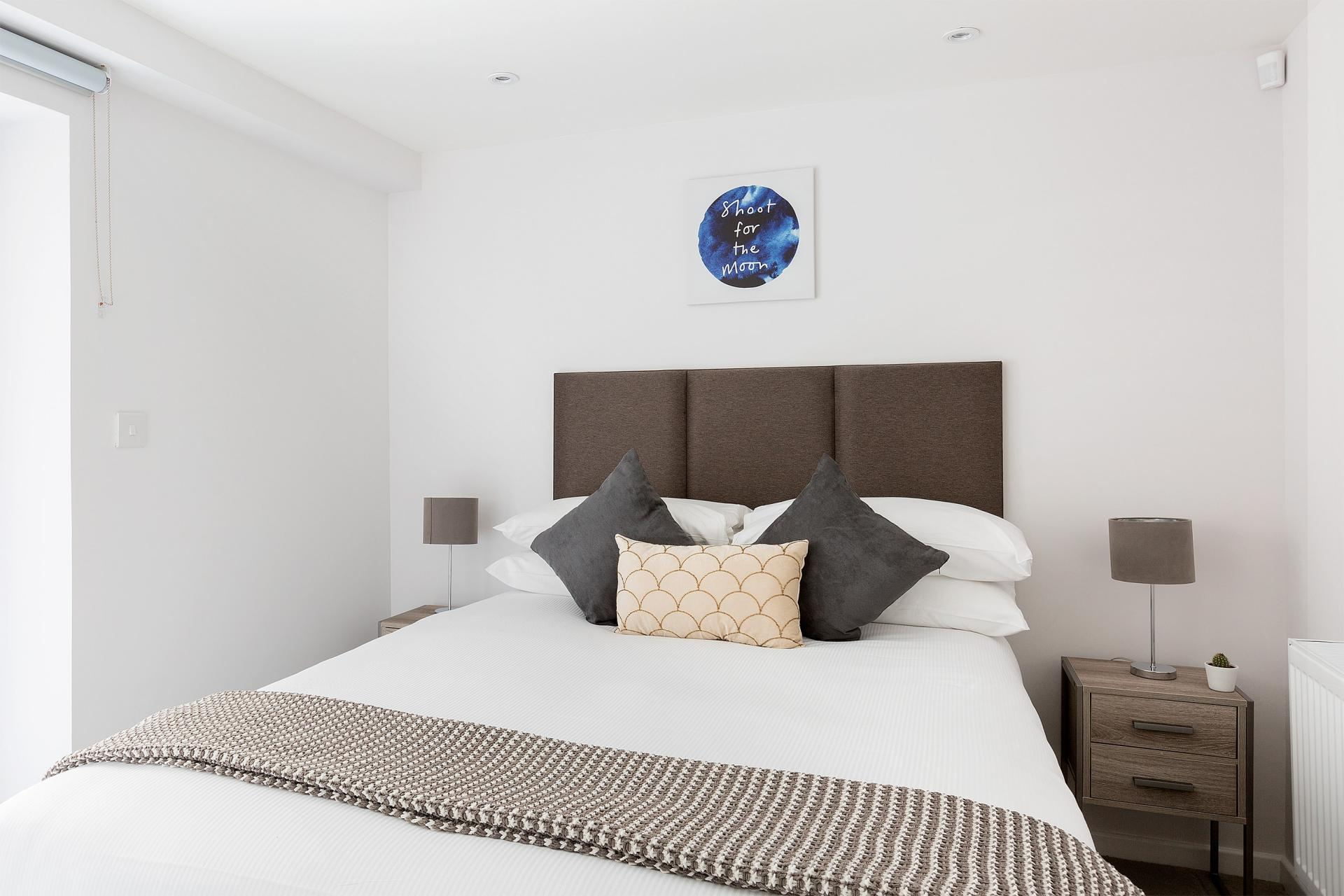 Double bed at Heart of Camden Apartments - Citybase Apartments