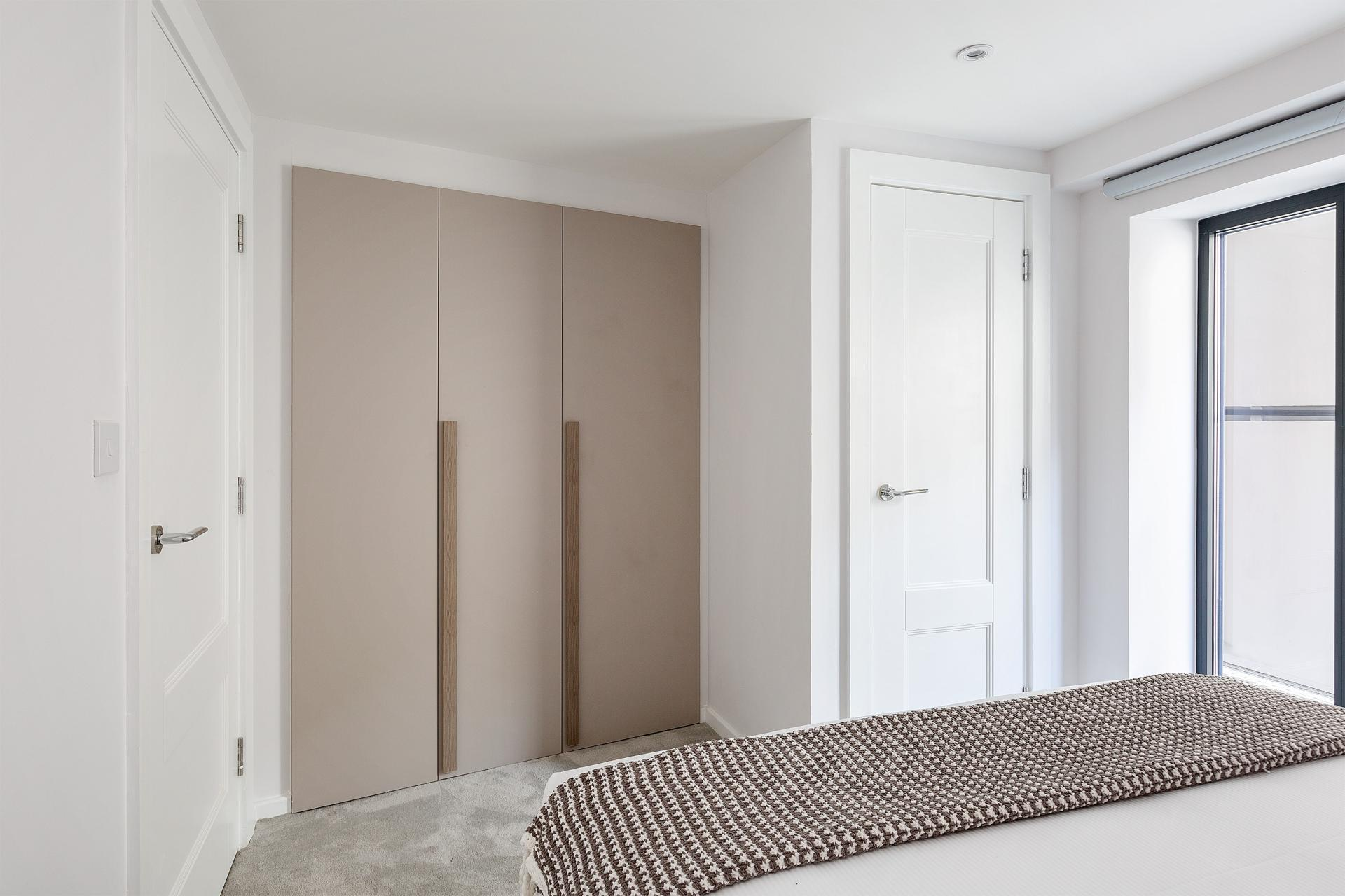 Modern bedroom at Heart of Camden Apartments - Citybase Apartments