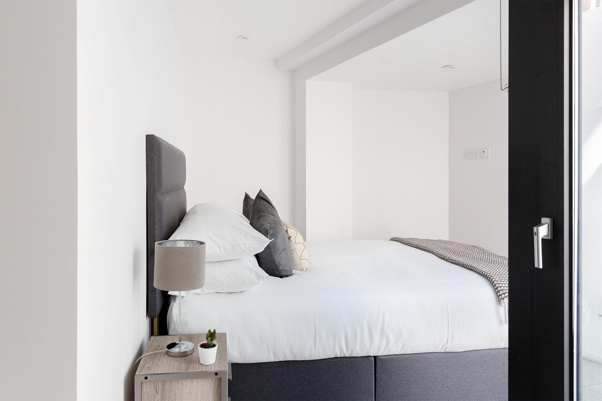 Cosy bedroom at Heart of Camden Apartments - Citybase Apartments