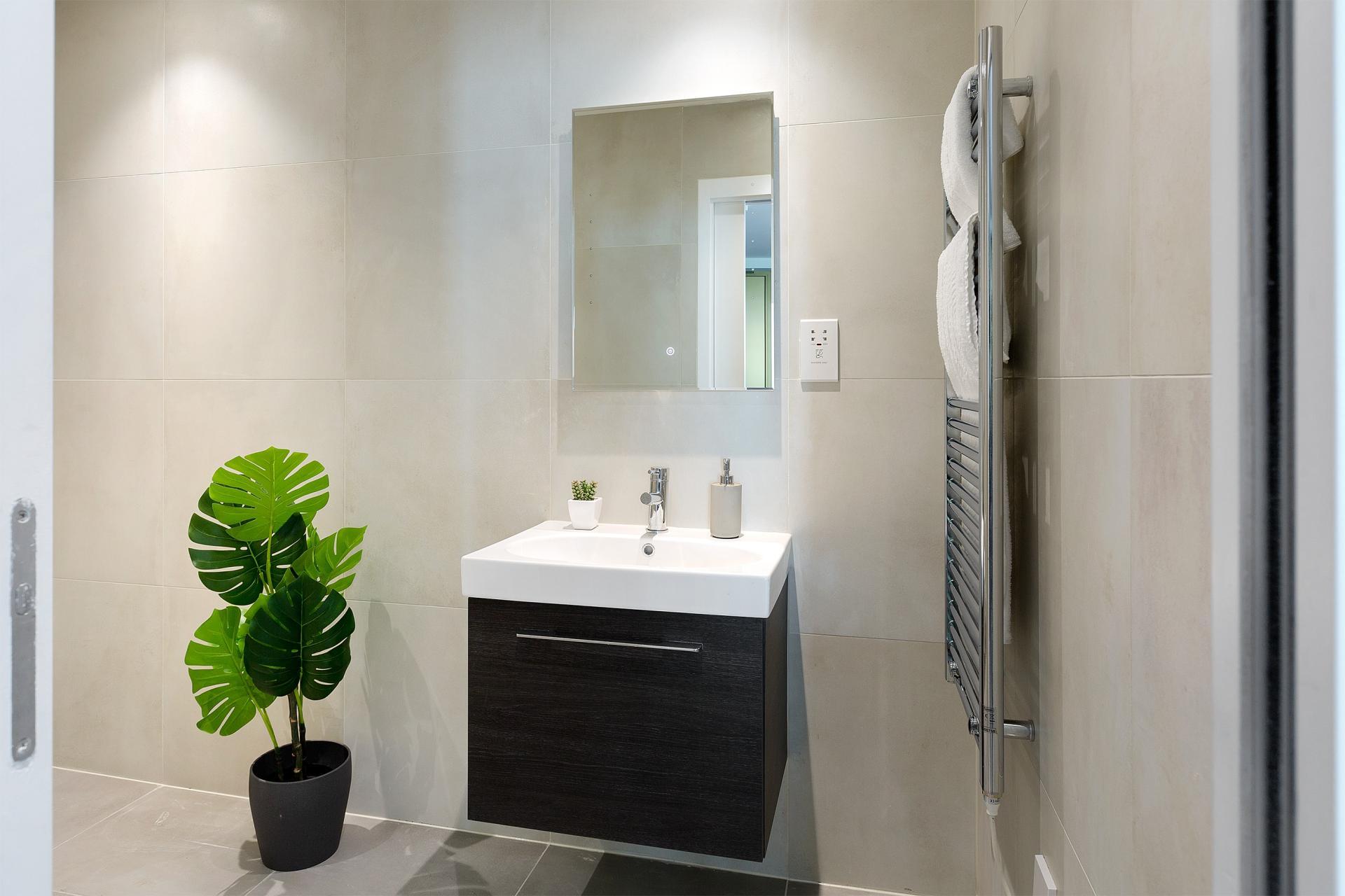 Sleek bathroom at Heart of Camden Apartments - Citybase Apartments
