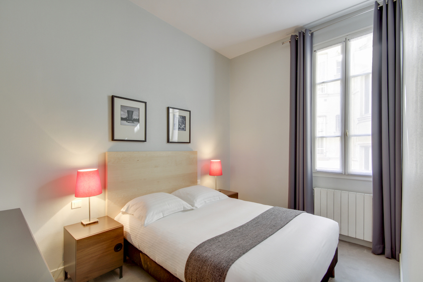 Bedroom at Rue Vaucanson Apartment - Citybase Apartments