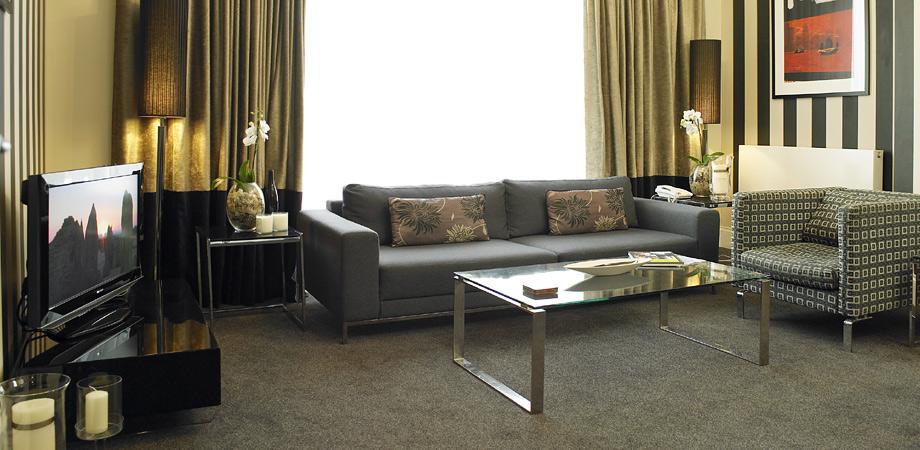 Sofa at Kensington House Apartments - Citybase Apartments