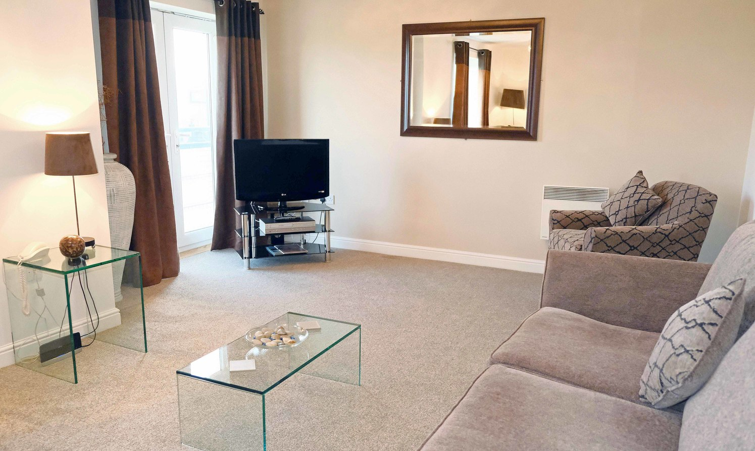 Living room at Knightsbridge Court Apartments - Citybase Apartments