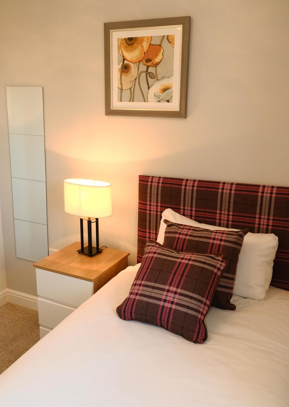 Stylish bedroom at Knightsbridge Court Apartments - Citybase Apartments