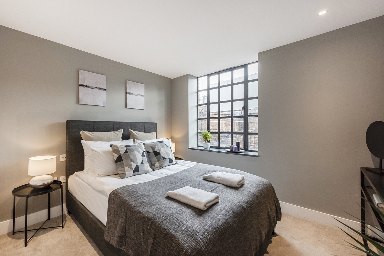Stylish bedroom at Bull Inn Court Apartment - Citybase Apartments