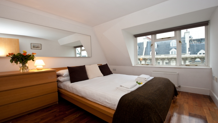 Tidy bedroom in High Street Kensington Apartments - Citybase Apartments