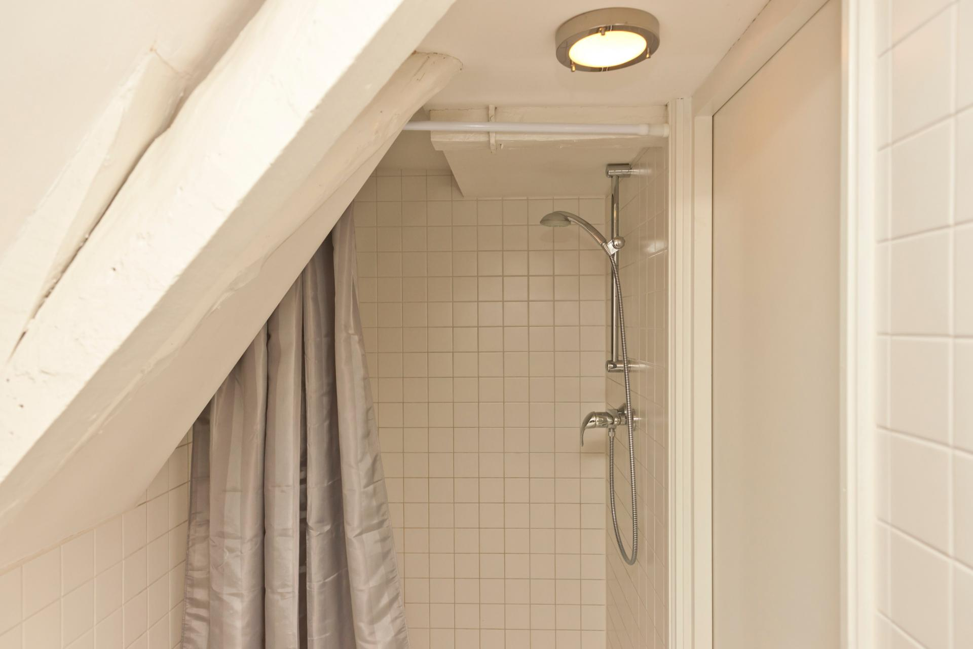 Shower at Jordaan Herenstraat Apartment, Amsterdam - Citybase Apartments