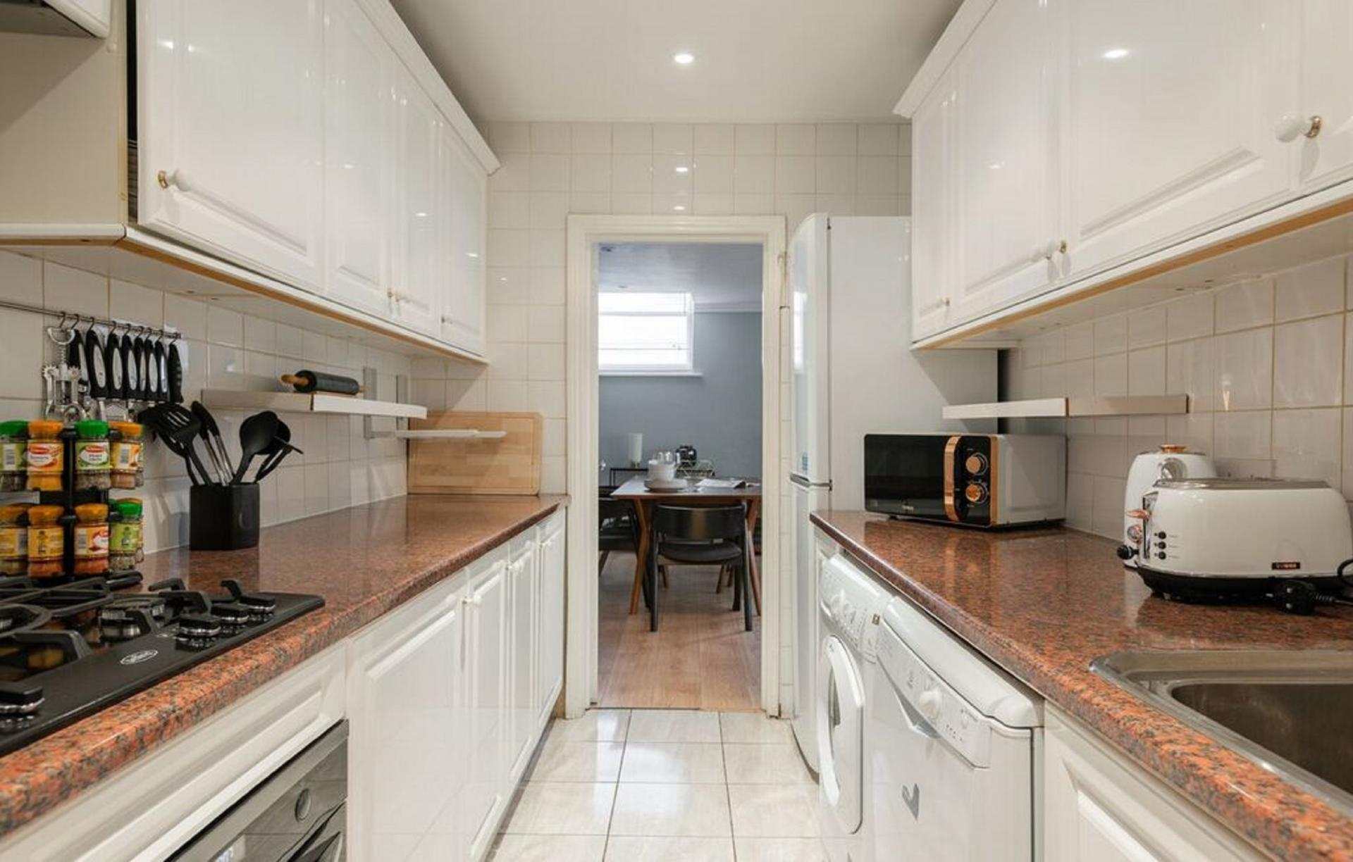 Fully equipped kitchen at The Kensington Palace Mews, Kensington, London - Citybase Apartments