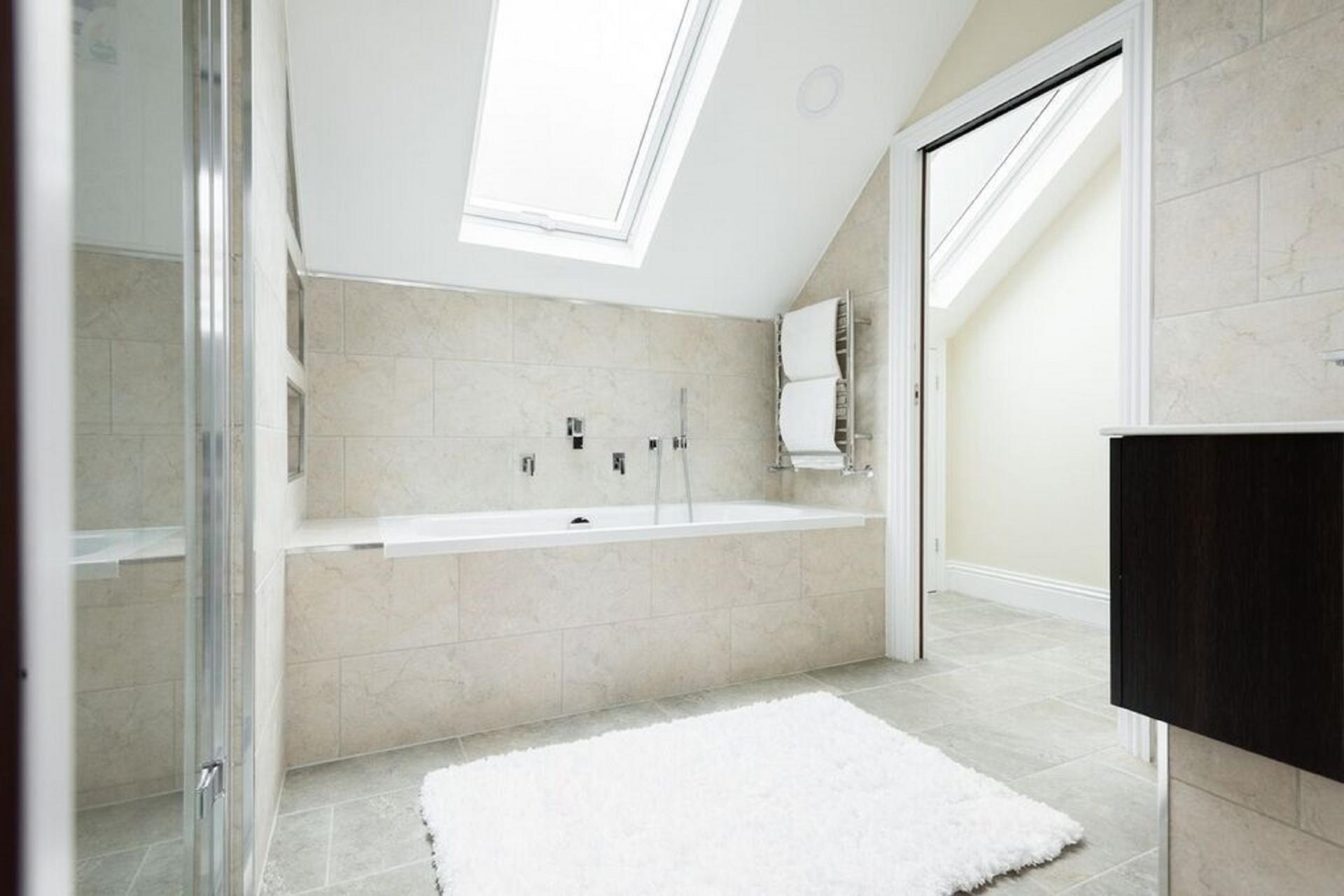 Bath at The Soho Studio Apartment, Paddington, London - Citybase Apartments