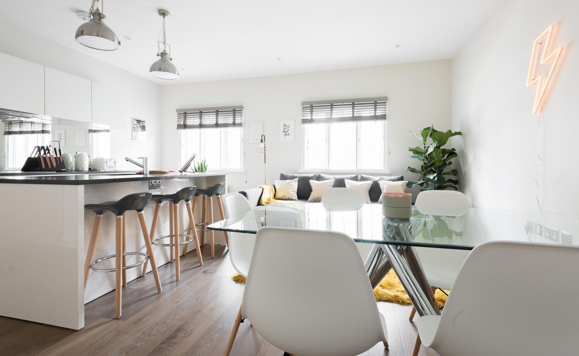 Dining table and chairs at The Soho Studio Apartment, Paddington, London - Citybase Apartments