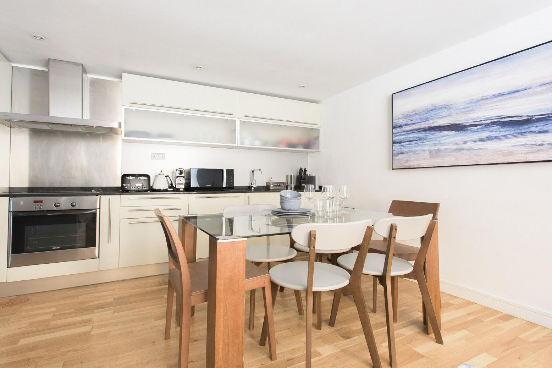 Dining chairs at The Paddington Maisonette, Paddington, London - Citybase Apartments