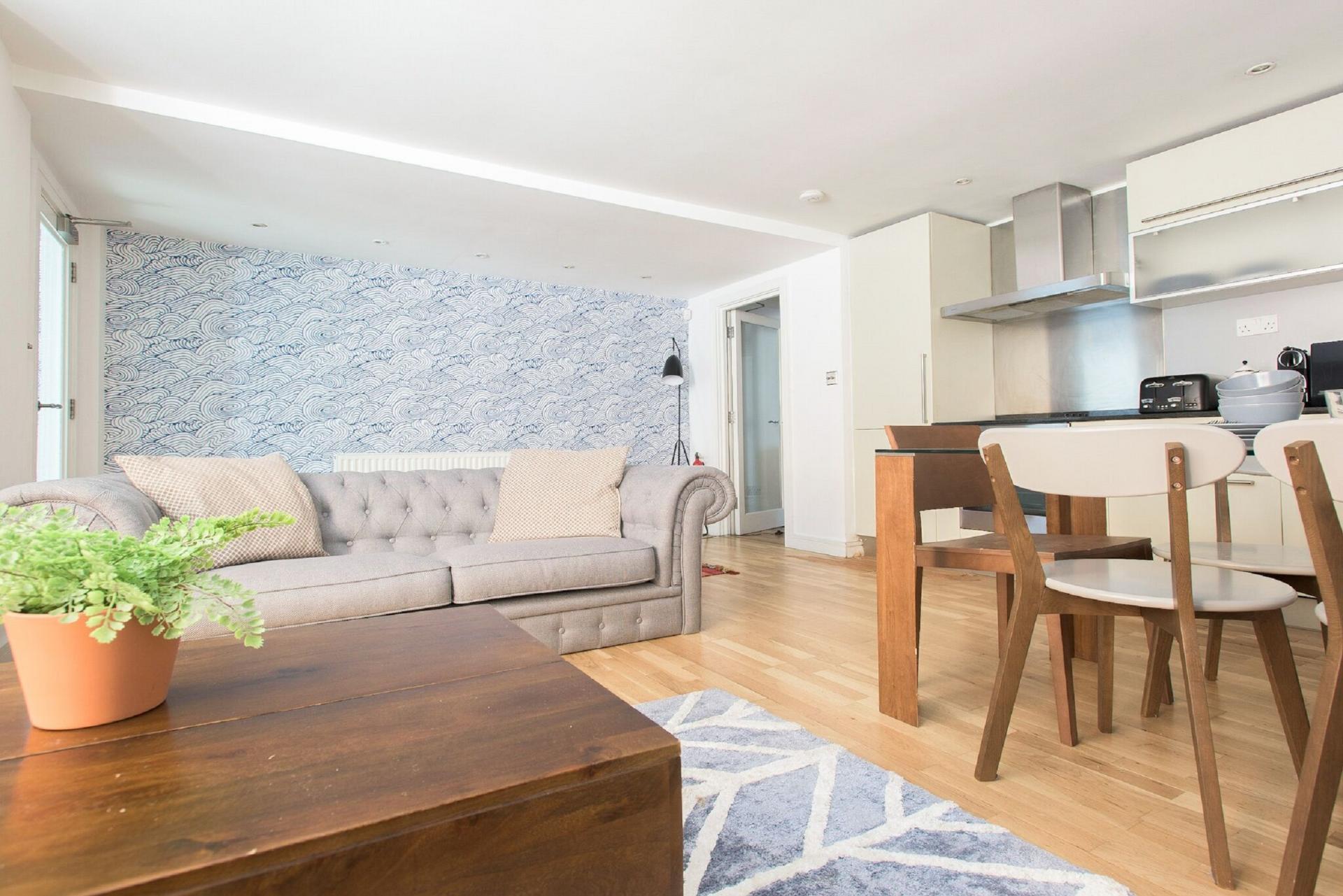 Comfy sofa at The Paddington Maisonette, Paddington, London - Citybase Apartments