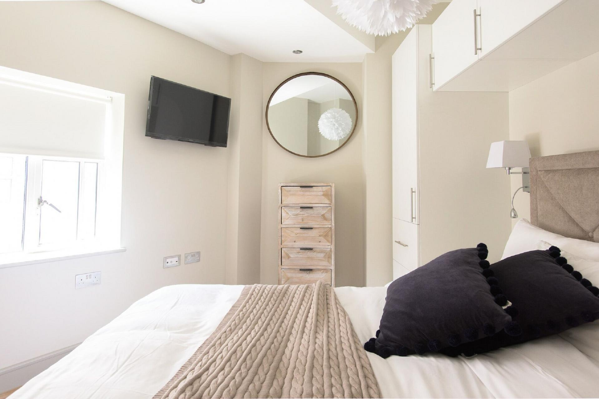 Bright bedroom at The Soho Loft, Mayfair, London - Citybase Apartments