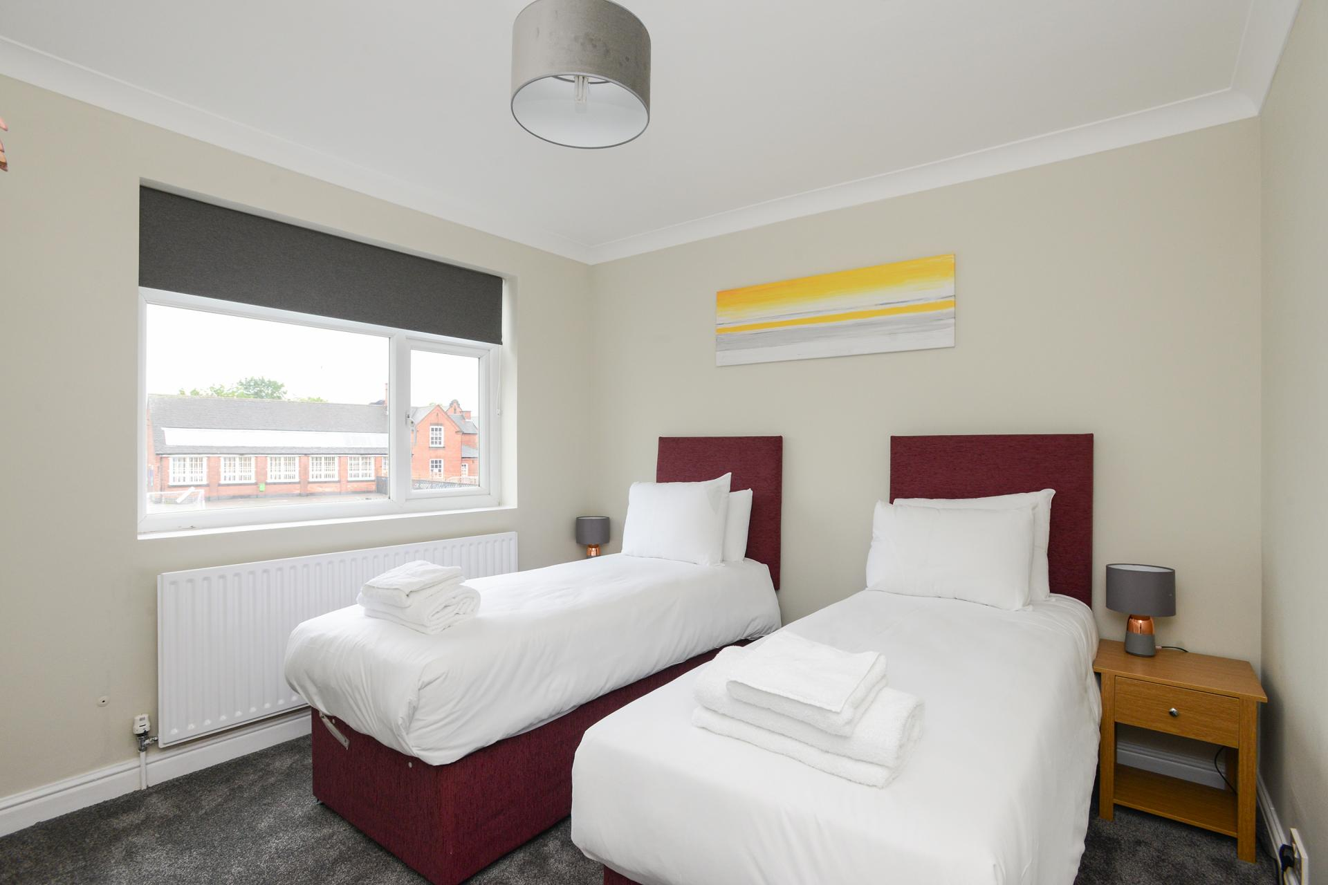 Twin beds at King Street House - Citybase Apartments